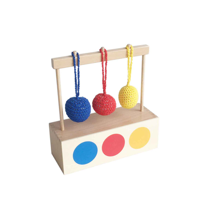 Imbucare box with 3 colored knit balls